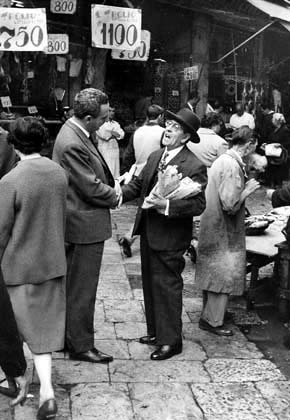 Palermo. Two gentlemen talking at the Vucciria market, 1960
